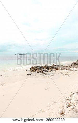 Gray Shack Ocean Rocks View With Islands