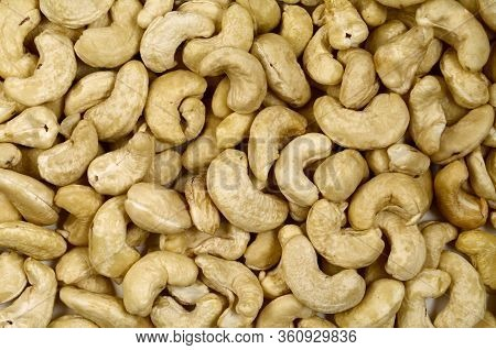 Cashew Nuts Pile Closeup. Cashew Nuts Photo Background. Organic Food. Tasty Healthy Snack. Scattered