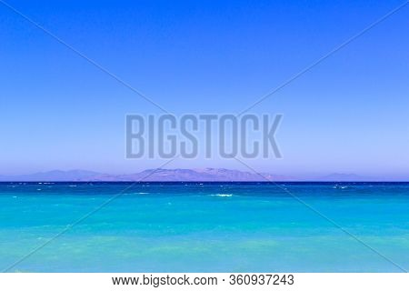 Simply Landscape With Sea Turquoise Color , Mountains On The Horizon And Gradient Blue Sky.horizon L