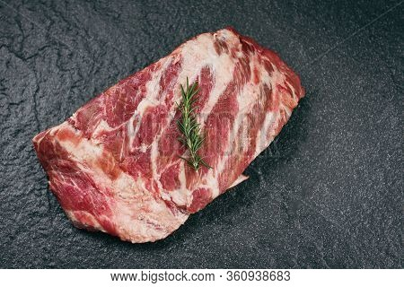 Raw Pork Ribs Meat On Black Plate Background / Fresh Pork Spare Ribs For Cooking Roasted Or Grilled