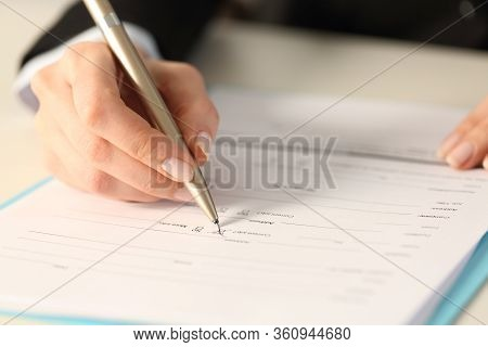 Close Up Of Executive Woman Hand Filling Form Checking Yes Checkbox Sitting On A Desk