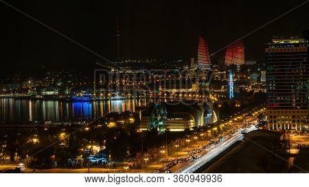 Baku, Azerbaijan - July 2019: Baku Cityscape At Night With Caspian Sea And Flame Towers