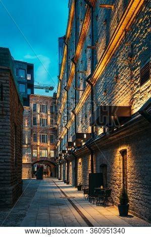 Tallinn, Estonia. Historical Rotermann City Quarter In Evening Illuminations. Rotermann Quarter Incl