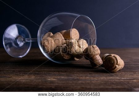 Large Decorative Glass Tumbler, Wine Glass On A Long Stem, Beautiful Filled With Wine Corks Lies On
