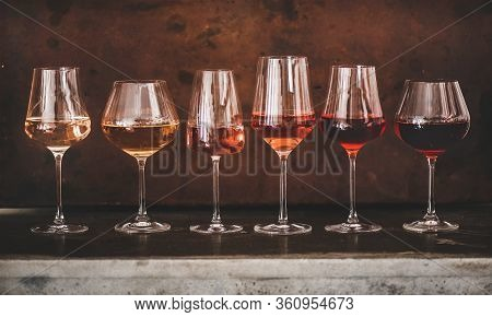 Shades Of Rose Wine In Glasses With Rusty Background