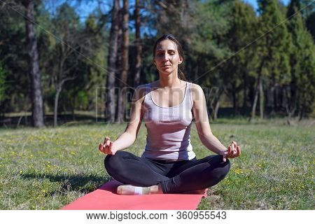Woman Doing Yoga In Nature. Yoga In Nature. Yoga Lifestyle. Healthy Lifestyle. Woman Doing Yoga On M