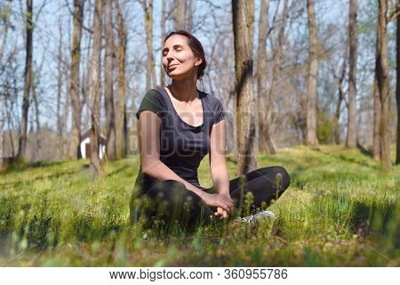 Beautiful Woman Smiling In Nature. Happy People Lifestyle. Woman Smiling In Sunshine. Nature Lifesty