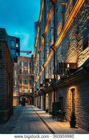 Tallinn, Estonia - December 5, 2016: Cafe In Historical Rotermann City Quarter In Evening Illuminati