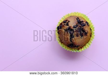 Cupcake With Chocolate Lies On A Pink Background