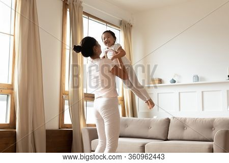 Mom Plays With Little Asian Daughter Lifting Her And Swaying