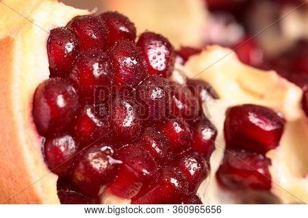 Pomegranate Seeds Macro Shot. Peeled Pomegranate. A Slice Of Ripe Pomegranate Closeup.