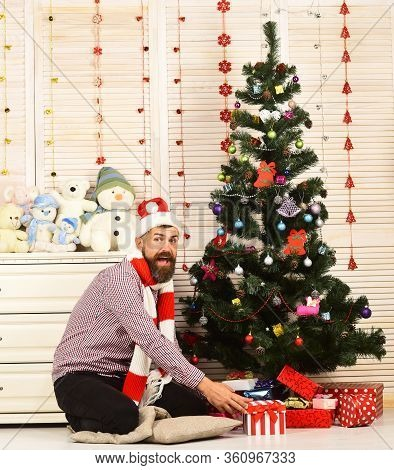 Santa Claus With Excited Face By Bureau With Toys