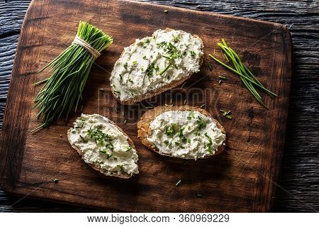Slices Of Bread With A Cottage Cheese Spread, Freshly Cut Chives, And A Bunch Of Chive Aside Placed