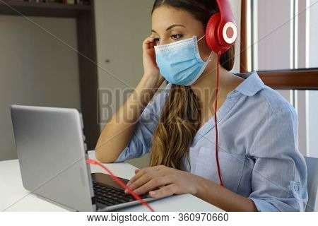 Covid-19 Pandemic Coronavirus Home Schooling E-learning Student Girl Mask Study From Home Laptop. Qu