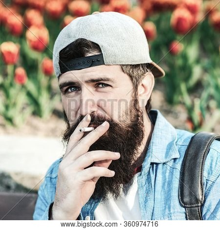 Bearded Hipster Smoking Cigarette Outdoors. Man Thinking About Something. Bearded Worker Has A Break