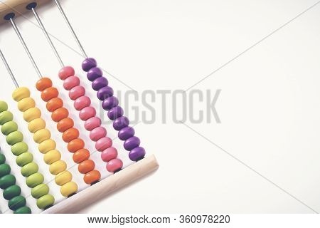Multi-colored Designer Background. Calculating Colorful Wooden Rainbow Abacus For Number Calculation