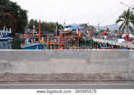 Concrete Wall. Local Fisherman Port, Fisherman Boat Mooring. Fisherman Village Near Pattaya Beach, T
