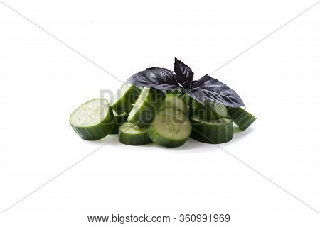 Sliced Cucumber Isolated On White. Cucumbers With Copy Space For Text. Cucumbers With Oregano Leaf I