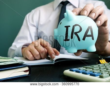 Ira Individual Retirement Account Concept. Manager Proposes Piggy Bank.
