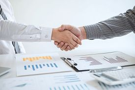 Finishing Up A Meeting Collaboration, Handshake Of Two Business People After Contract Agreement To B