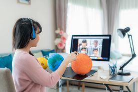 Asian Woman Teacher Teaching Solar System Via Video Conference E-learning And Cheerful Elementary Sc