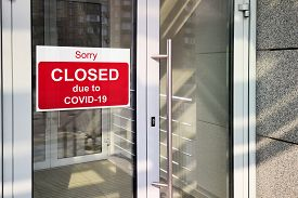 Business Center Closed Due To Covid-19, Sign With Sorry In Door Window. Stores, Restaurants, Offices