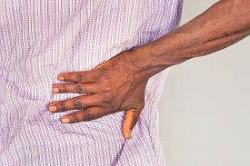 Close-up View Of  African Man With Pain In Kidneys On Gray Background.  African Man With Back Ache C