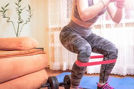 Girl Fitness Stay Home. Young Fitness Sporty Girl Training At Home Workout And Yoga Exercises. Healt