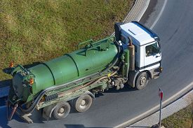 Truck With Green Tank For Pumping Waste Or Contaminated Water