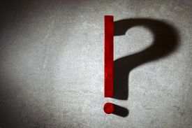Exclamation Point Lit In Spotlight Changes Into A Question Mark From Shadow. Question Mark, Exclamat