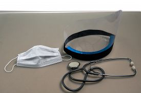 Stethoscope, Mask, And Face Shield To Keep From Getting The Coronavirus. Medical Protective Equipmen
