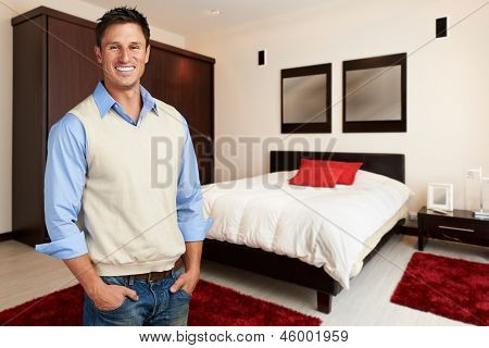Young successful casual man at bedroom