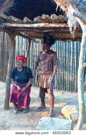 Zulu warrior with his wife in Shakaland Zulu Village, South Africa