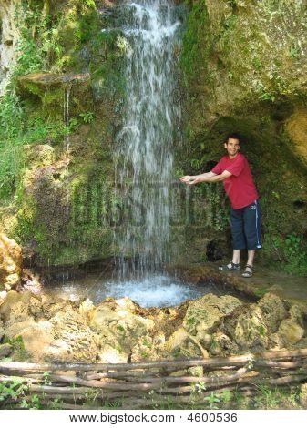 Man At The Waterfall