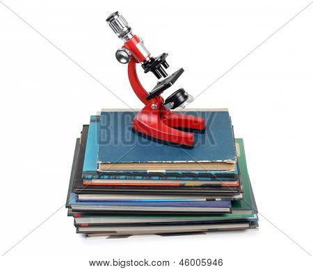 Color photo of a microscope on stack of books