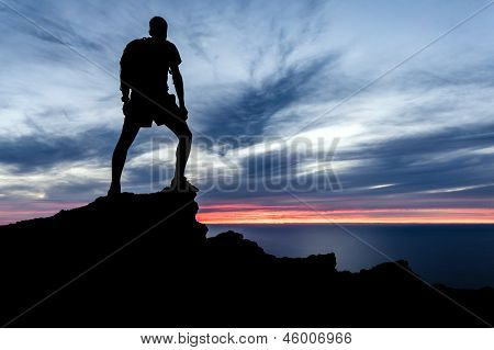 Man Hiking Silhouette In Mountains, Ocean And Sunset