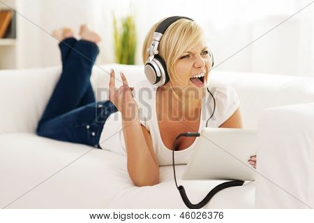 Woman listen to rock music at home