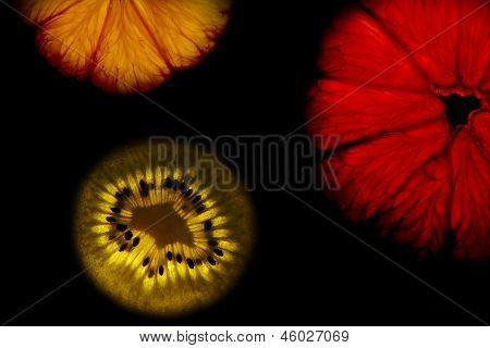 Colorful highlighted fruits on black background