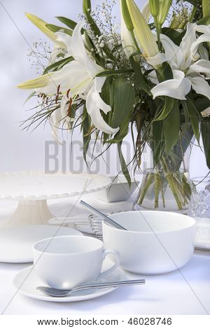 White Breakfast Table Setting With Lily Flowers