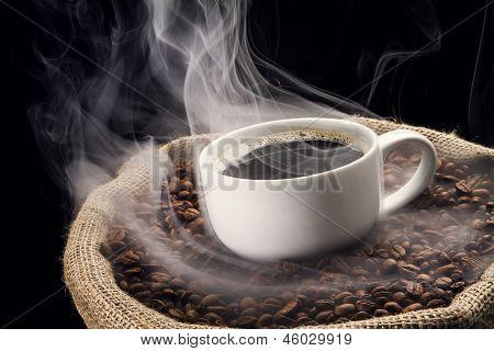 Sack full of still hot freshly roasted coffee beans.