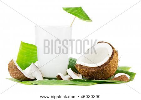 Big glass of coconut milk with coconuts on a white background