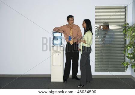 Businessman spying on coworkers