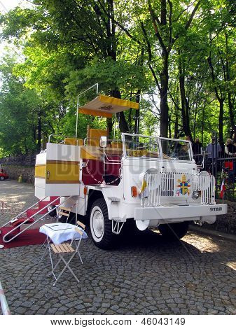 PIEKARY SLASKIE POLAND - MAY 26: reconstruction Polish pappamobile of 1979 the first papal vehicle made outside the Vatican shown during the pilgrimage men in Piekary Sl. on May 26 2013 poster
