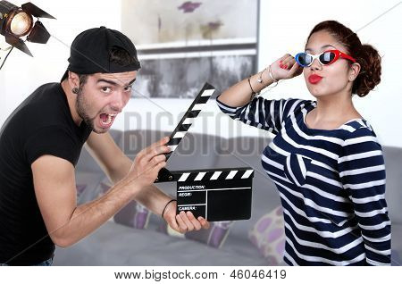 Man Holding Clapper Board And Woman Actress