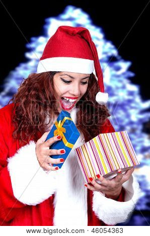 Beautiful Brunette Wearing Santa Claus With Gift