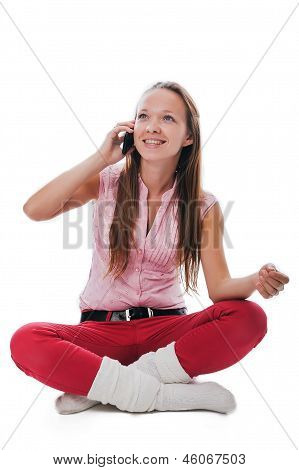 Girl Smiling And Talking On A Mobile Phone
