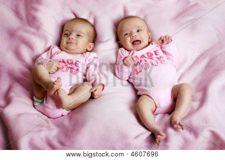 Fraternal Twins On A Pink Blanket