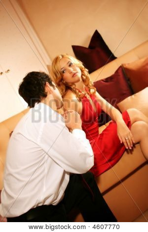 A Couple Is Sitting On A Lounge - The Man Is Saying Sorry