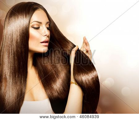 Hair. Beauty Fashion Model Woman touching her Long and Healthy Brown Hair. Beauty Brunette Girl isolated on white background.