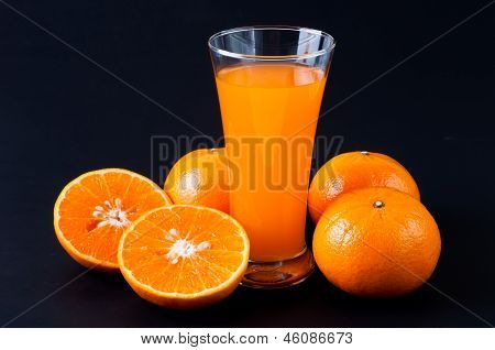 Orange Juice Glass And Orange Fruit